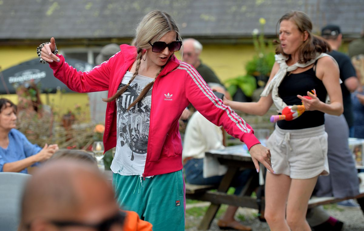 People enjoying the afternoon at the Six Bells during the Michaelmas Fair