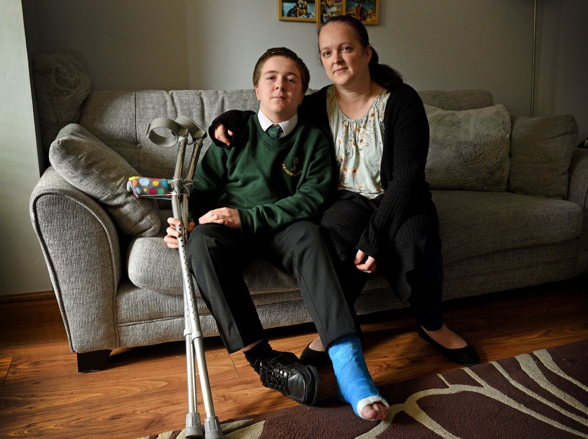 Joe Warren, seen with mum Angela, suffered leg injuries after being hit by a car while riding his bike