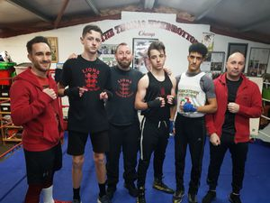 Coach Kevin Dillon, third left, with members of the Lions Amateur Boxing Club