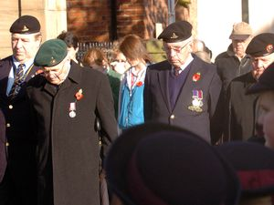 Old soldiers and children from Bellan House School during the two minutes silence at Oswestry remembrance service, by Cae Glas Park gates. SAME DAY..