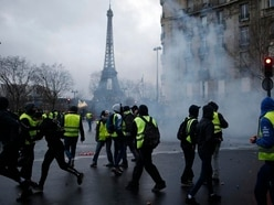 Macron to address France as protests shake government