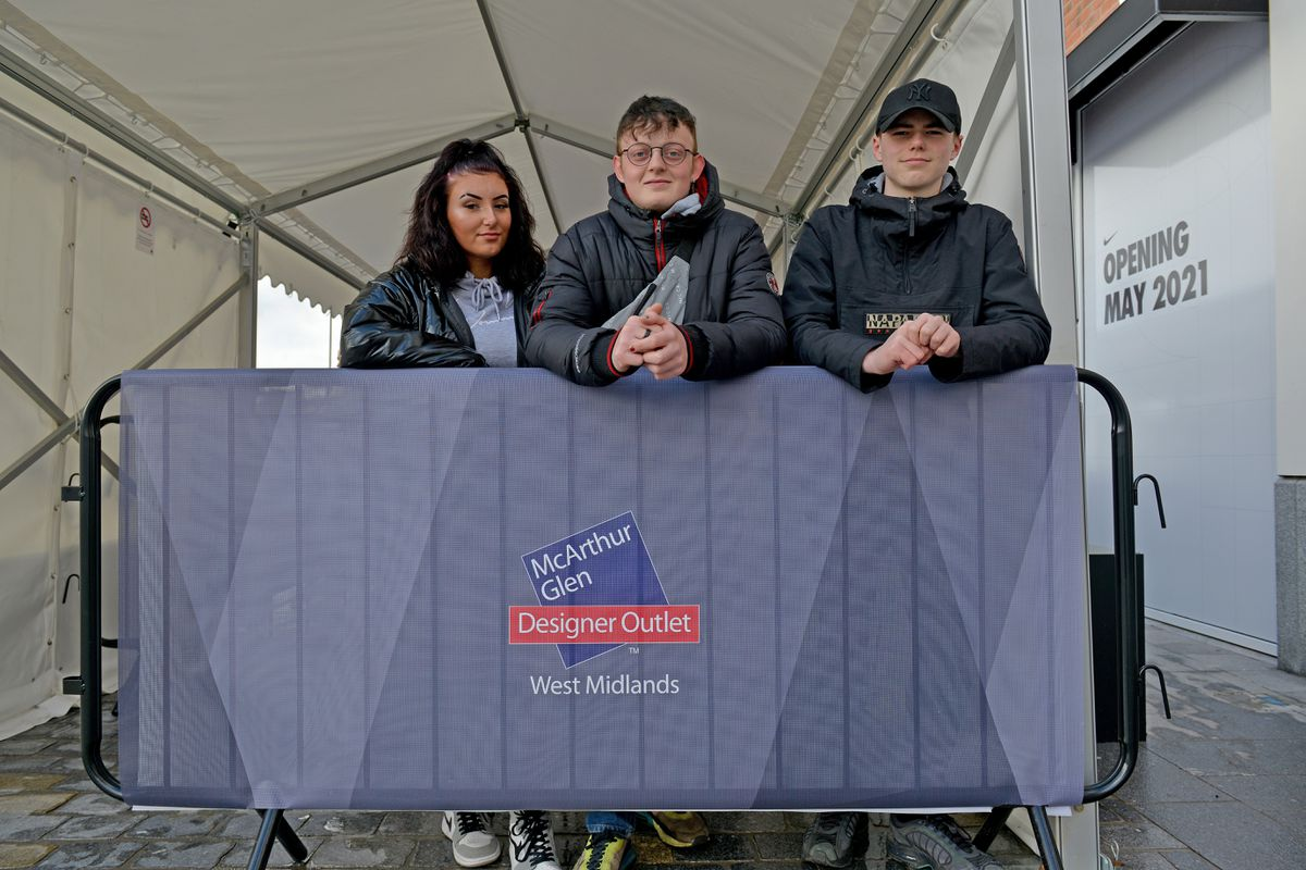 Shoppers arrive at the newly-opened designer outlet at Cannock. First in the queue were: Olivia Hopton, Samuel Cooper and Harry Cantaill