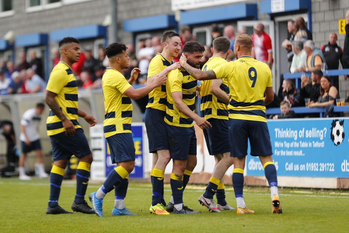 Brad Sharman of Shifnal Town celebrates with his team mates after scoring a goal to make it 1-0 Pic: James Baylis