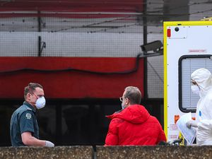 Medical staff wearing personal protective equipment (PPE)outside St Thomas' Hospital in Westminster, London, as the UK continues in lockdown to help curb the spread of the coronavirus. PA Photo. Picture date: Monday March 30, 2020. A total of 1,228 patients are reported to have died after testing positive for coronavirus in the UK. See PA story HEALTH Coronavirus. Photo credit should read: Victoria Jones/PA Wire.