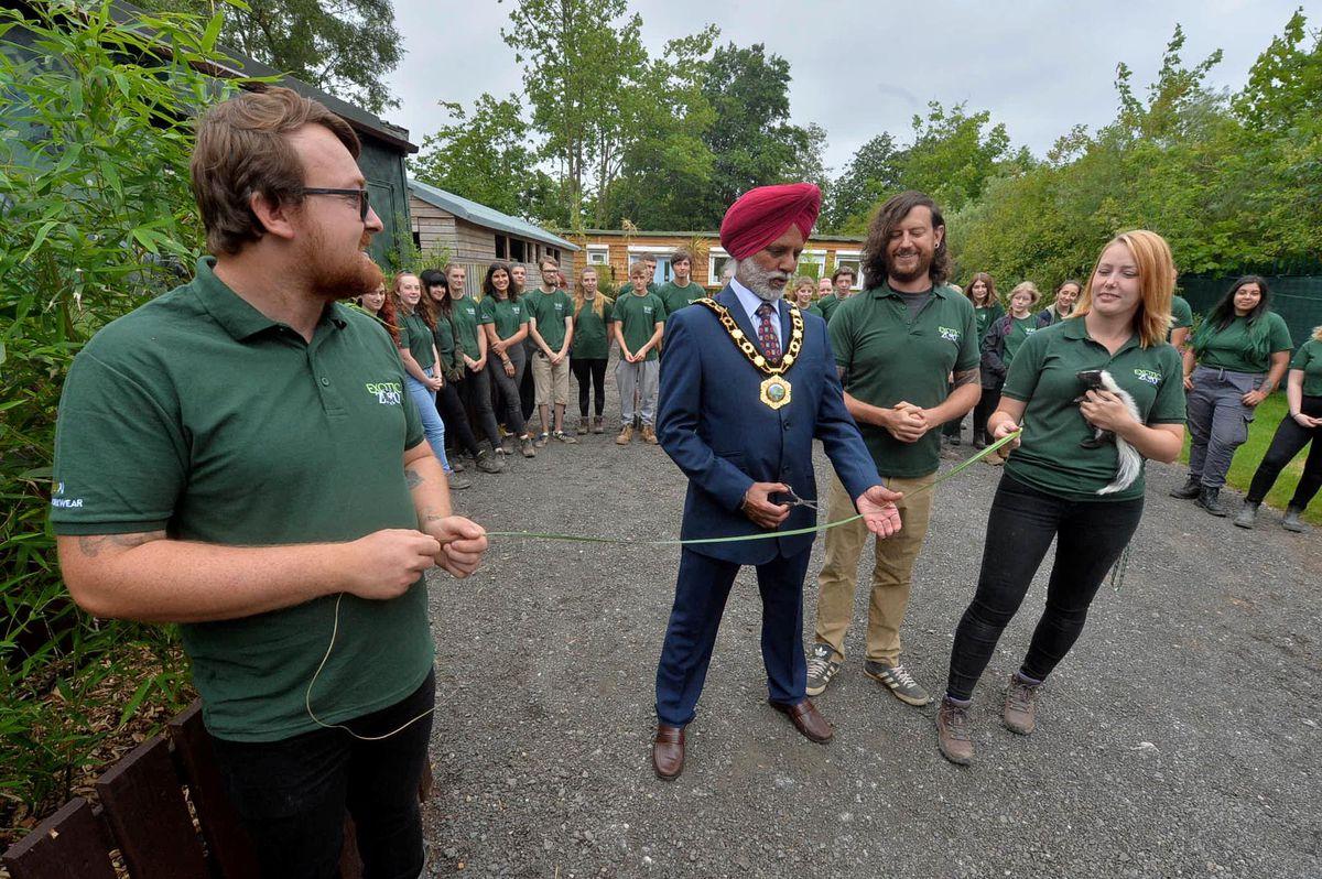 Telford & Wrekin mayor Amrik Jhawar cuts a long blade of grass to open the site