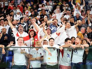 England fans celebrate after the 2019 Rugby World Cup Semi Final match at International Stadium Yokohama