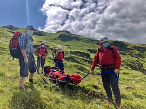 Rescuers with the injured man on Graig y Bwlch