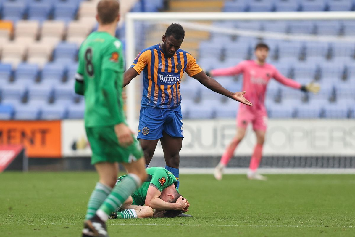 James Roberts of Oxford City reacts on the floor after a challenge from Aaron Pierre of Shrewsbury Town which results in a red card from both players. (AMA)