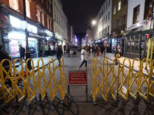 Old Compton Street in Soho, London, after pubs and restaurants were subject to a 10pm curfew