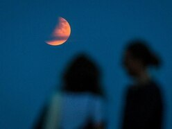 Partial lunar eclipse lights up skies 50 years on from Apollo 11 launch