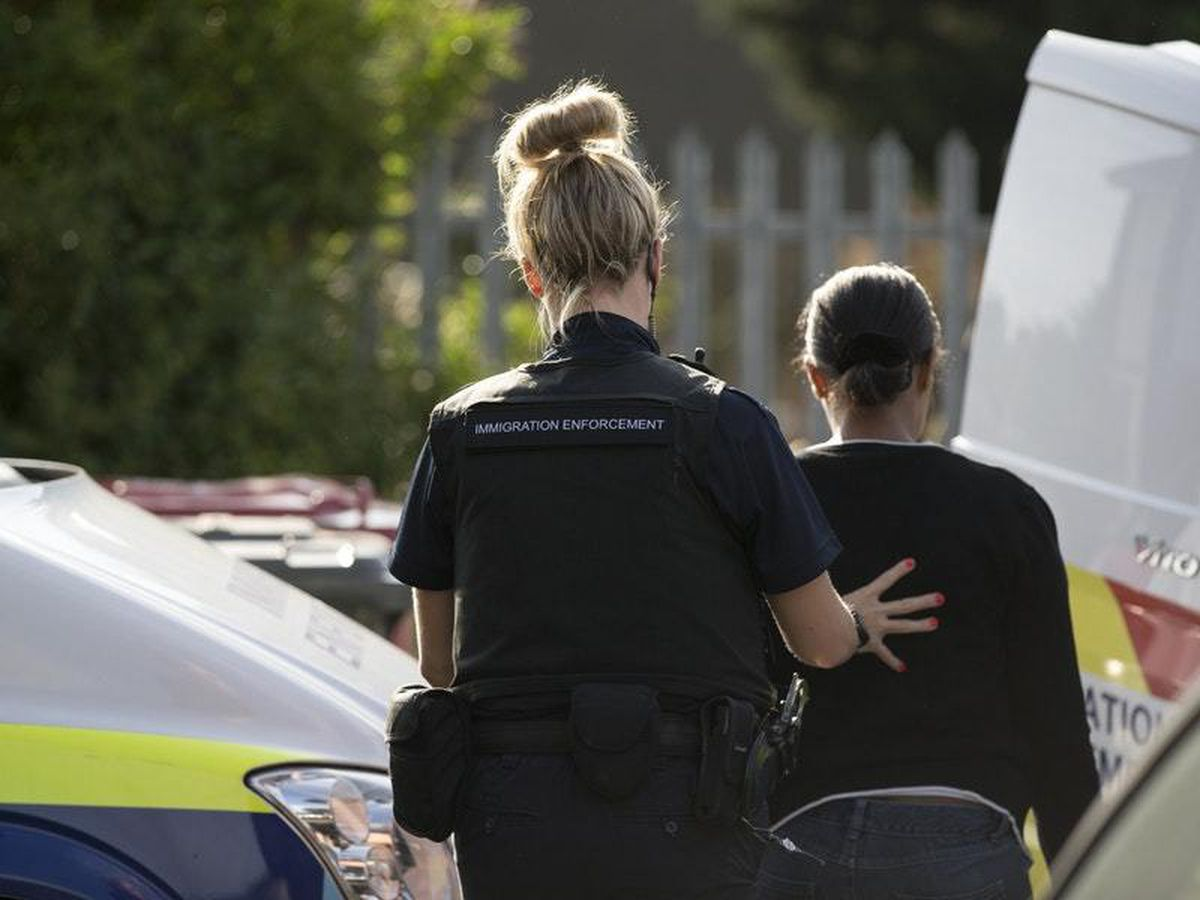 Immigration Enforcement officers arrest an individual, as the Home Office is urged to examine its approach to detaining immigrant families
