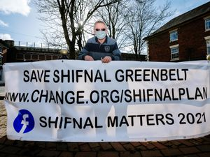 LAST COPYRIGHT SHROPSHIRE STAR JAMIE RICKETTS 22/02/2021 - John Moore of Shifnal Matters 2021 taking down the banners as the consultations on plans for homes in the town have now ended. They have had over 2000 signatures on their petition after the campaign..