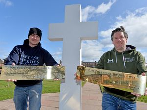 LAST COPYRIGHT TIM STURGESS SHROPSHIRE STAR...... 27/03/2021.  Councillors including Jay Gough, left,  have paid for brand new brass plaques to replace the scuzzy old ones on the Donnington war memorial. Pictured with Brett Murray..