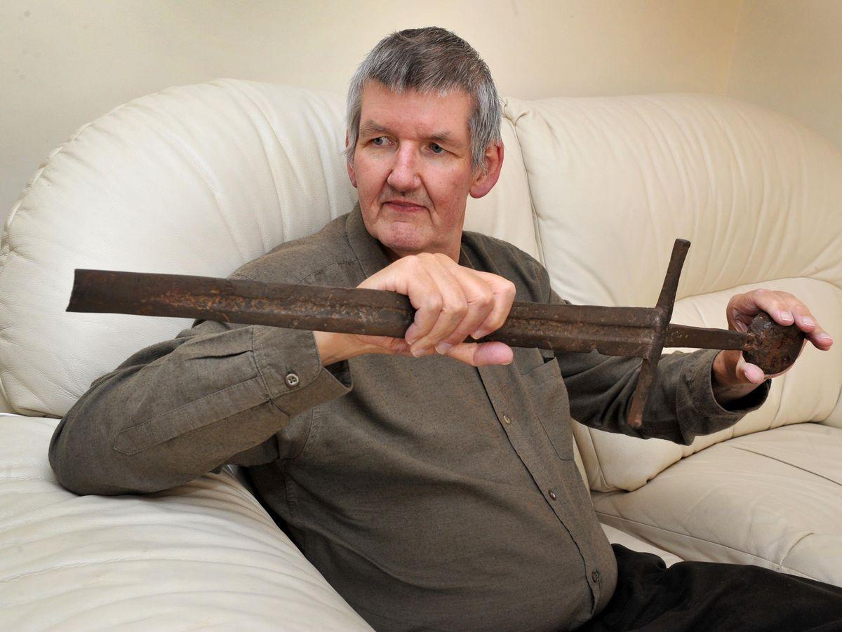 Mark Lawton with the sword
