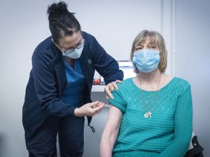 Nurse Sarah MacLeod, from the Vaccination Team, gives Margaret Swift, aged 69, from Balgreen, Edinburgh, her vaccine