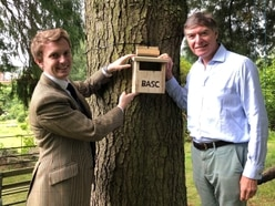MP Philip Dunne puts up birdbox after talks on 'vital role' of conservation work