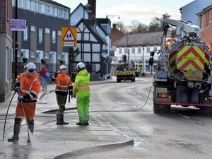 Council workers clear up the mess caused by the flooding in Coleham, Shrewsbury