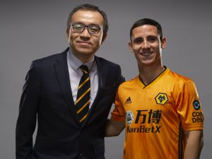 Podence with chairman Jeff Shi (Credit: Wolves)