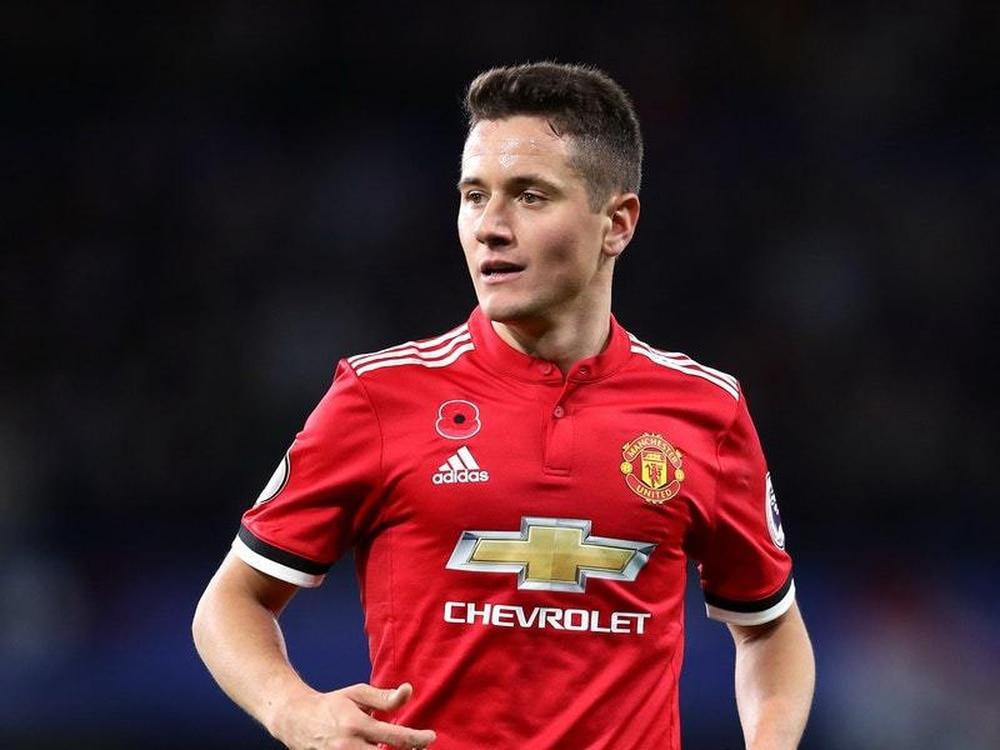 Man United's Herrera denies spitting on City crest