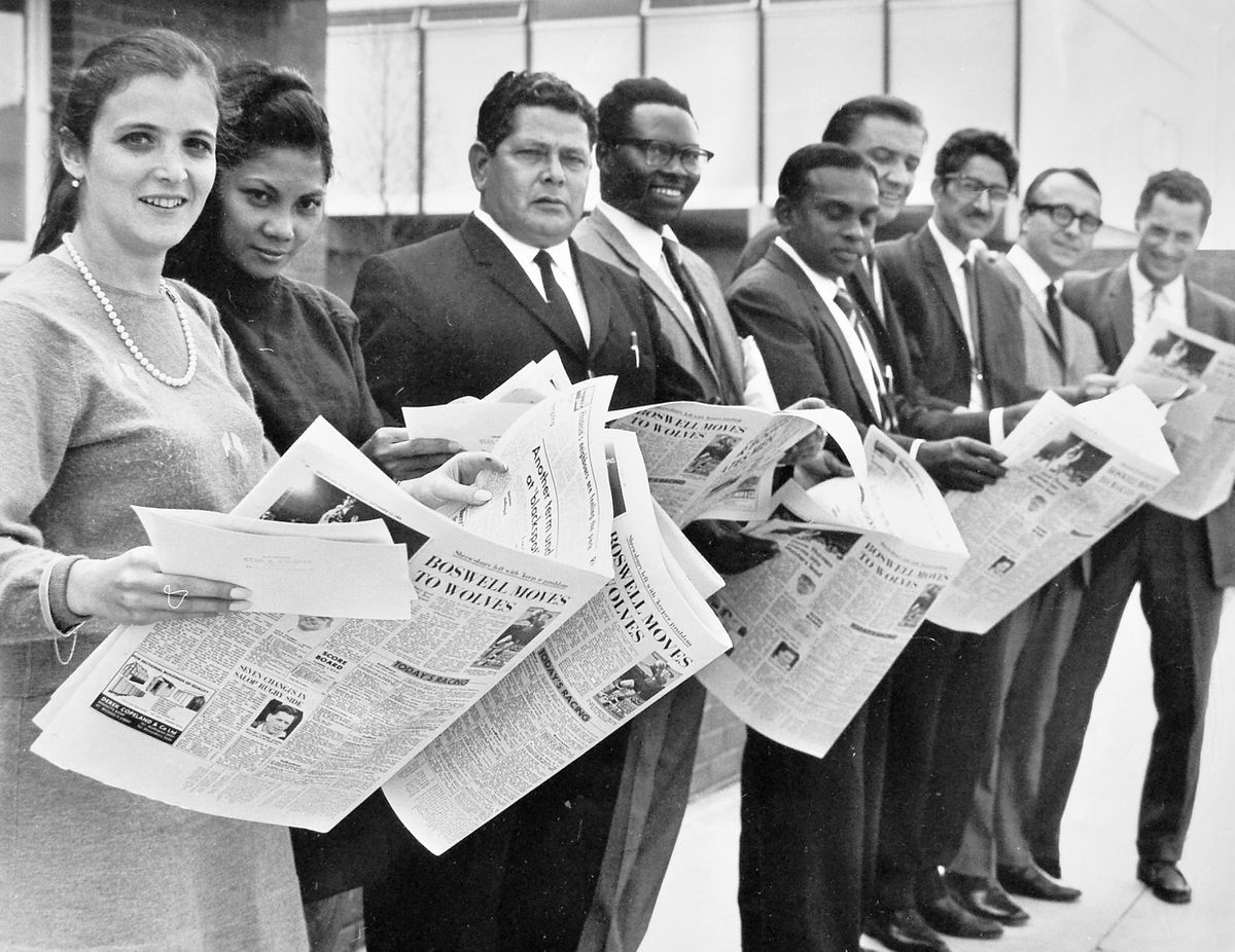 Twenty five delegates of local authorities from all over the world visited Dawley New Town in September 1968 – its successor Telford New Town was destined to be announced just a few weeks later. Here some of the representatives are seen at the Sutton Hill estate, looking at a Shropshire Star picture of their visit. (Not this picture, obviously).