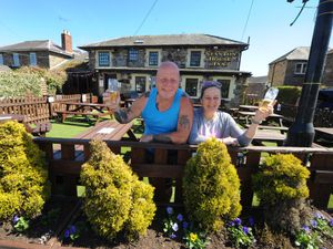 BORDER PIC / DAVID HAMILTON PIC / SHROPSHIRE STAR PIC 22/4/21 Getting ready to welcome drinkers back to their beer garden, converted from an old car park, landlord Mark Jones, and landlady Chelly Jones, at Stanton House Inn, Chirk, Wrexham..