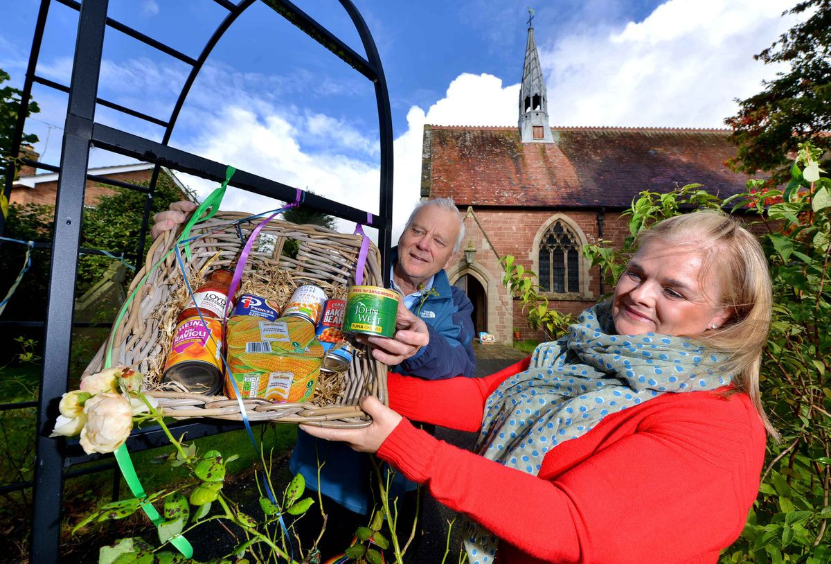 The harvest basket is available at the church until this Sunday. Pictured here helping out are parishioners Janet Kind and Stephen Butterfield
