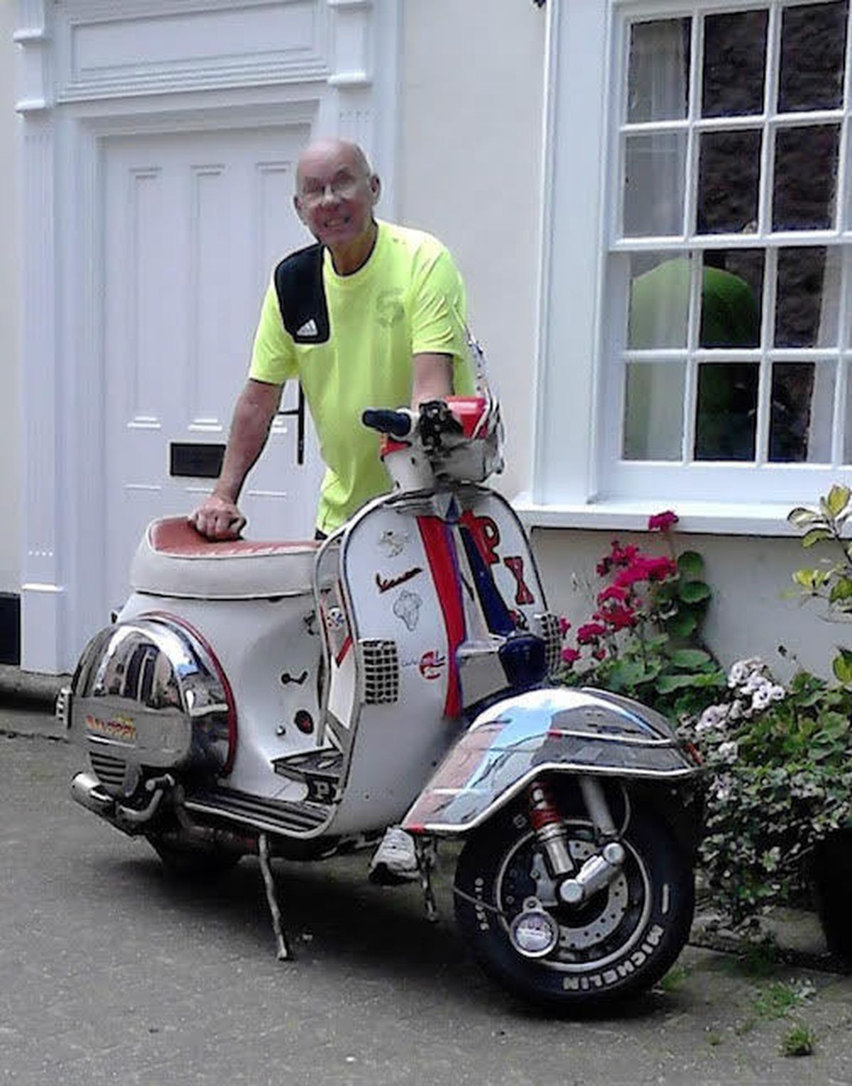 Kenny Barber poses with a moped in Tenby in 2011