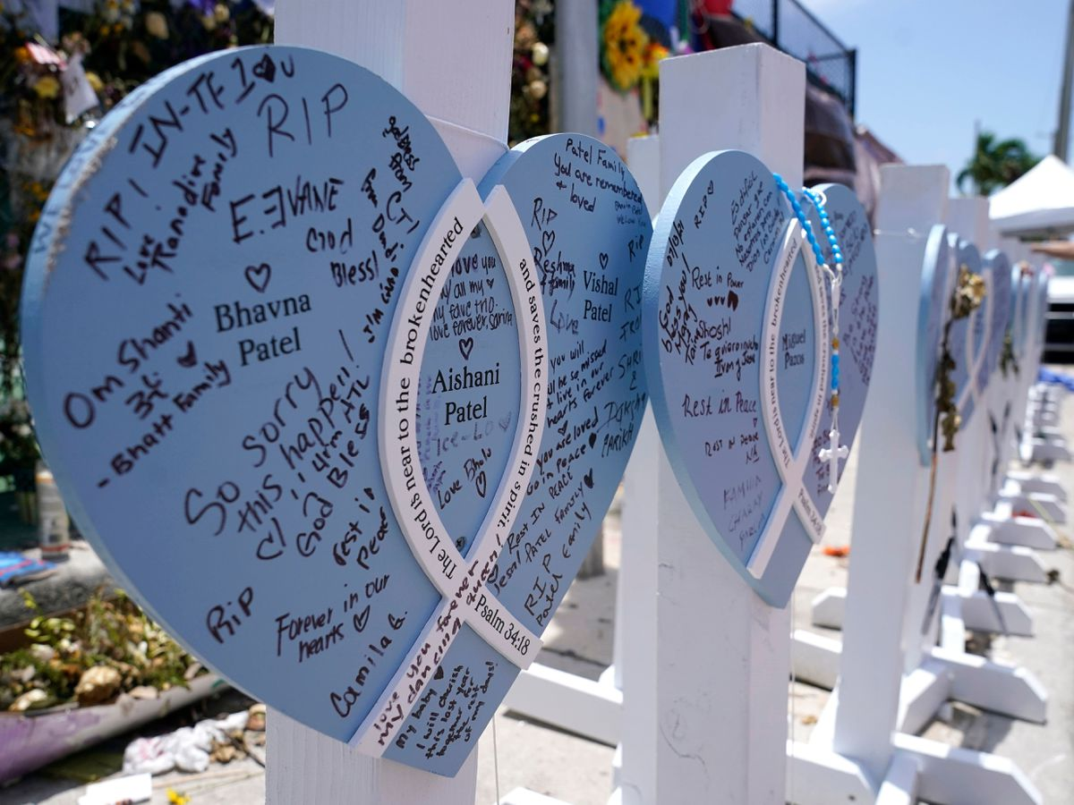 A wooden heart at a makeshift memorial for the victims of the collapse of the Champlain Towers South building