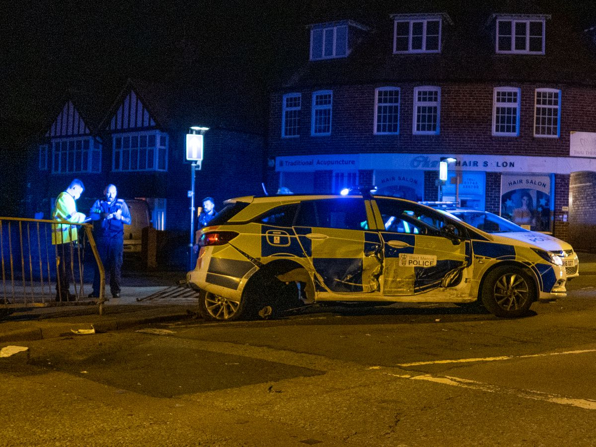 A police car sustained damage in the collision. Picture: Bob Griffiths