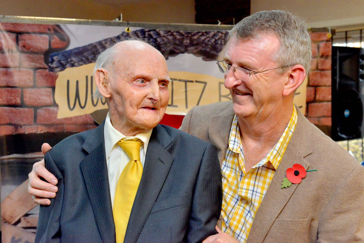Les Cherrington pictured with son Graham at his 100th birthday party