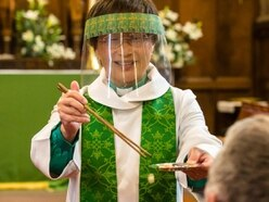 Vicar uses chopsticks in Holy Communion safety measure