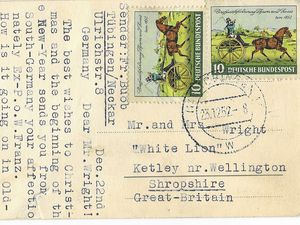 """nostalgia pic. Ketley. A postcard which was addressed to Mr and Mrs Wright, """"White Lion,"""" Ketley. Printed with the image of a snowly building on the front is Printed on the front is: 'Universitatsstadt Tubingen, Herzliche Gluckwuusche zum Jahreswechsel.' This translates as 'University town Tubingen, Congratulations for the New Year.' The postcard was emailed in by Andrew Brooks i.e.: anand.brooks@btinternet.com: """"I note from your website the article about the White Lion closing. The attached postcard was sent to Mr & Mrs Wright (landlords?) at the pub in 1952. The sender was a German ex-POW who had spent time at Ketley (was there a POW camp?) and did not go home until 1948. One of your readers may remember more details. Best Wishes..Andrew Brooks"""" The message on the back is: """"Sender: Fr. Buob Tubingen/Neckar, Ulrichstr.8, Germany. Dec. 22nd. Dear Mr. Wright! The best wishes to Christmas and the beginning of the New-Year sends you from South-Germany your affectionately Ex-P.o.W. Franz. How is it going on in Old-England? I would be extremely pleased to hear anything from you. After I have got your reply I will write you more about my doings in 1948. For today many king regards, yuor Franz."""" Library code: Ketley nostalgia 2020.."""