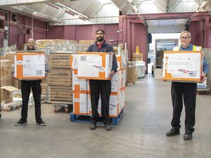 Herbert Rose, Amandeep Corotana and Colin Neville take delivery of some of the PPE donated by Fosun