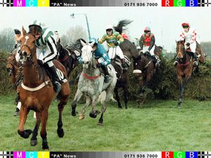 Lord Gyllene clears another fence and establishes a firm lead from the start of the 1997 Grand National at Aintree.