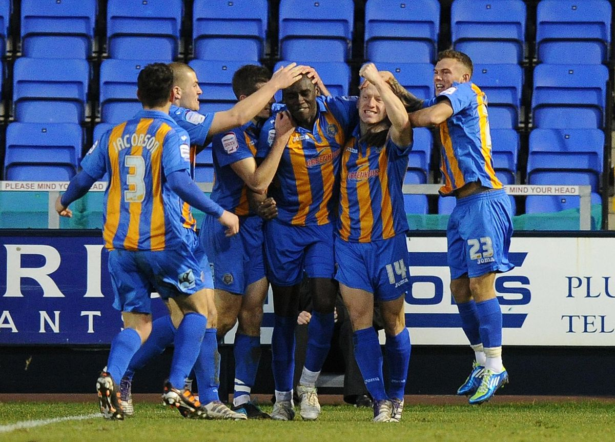 Shrewsbury players mob Shrewsbury Town's Jermaine Grandison after he scores his team's winning goal during the npower Football League Two match at Greenhous Meadow, Shrewsbury.