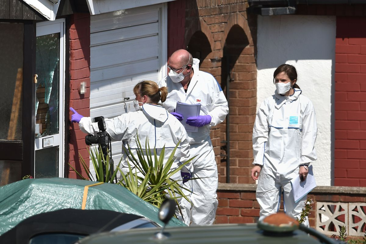 Forensic officers at the scene in Meadow Close, Telford. Photo: Joe Giddens/PA Wire