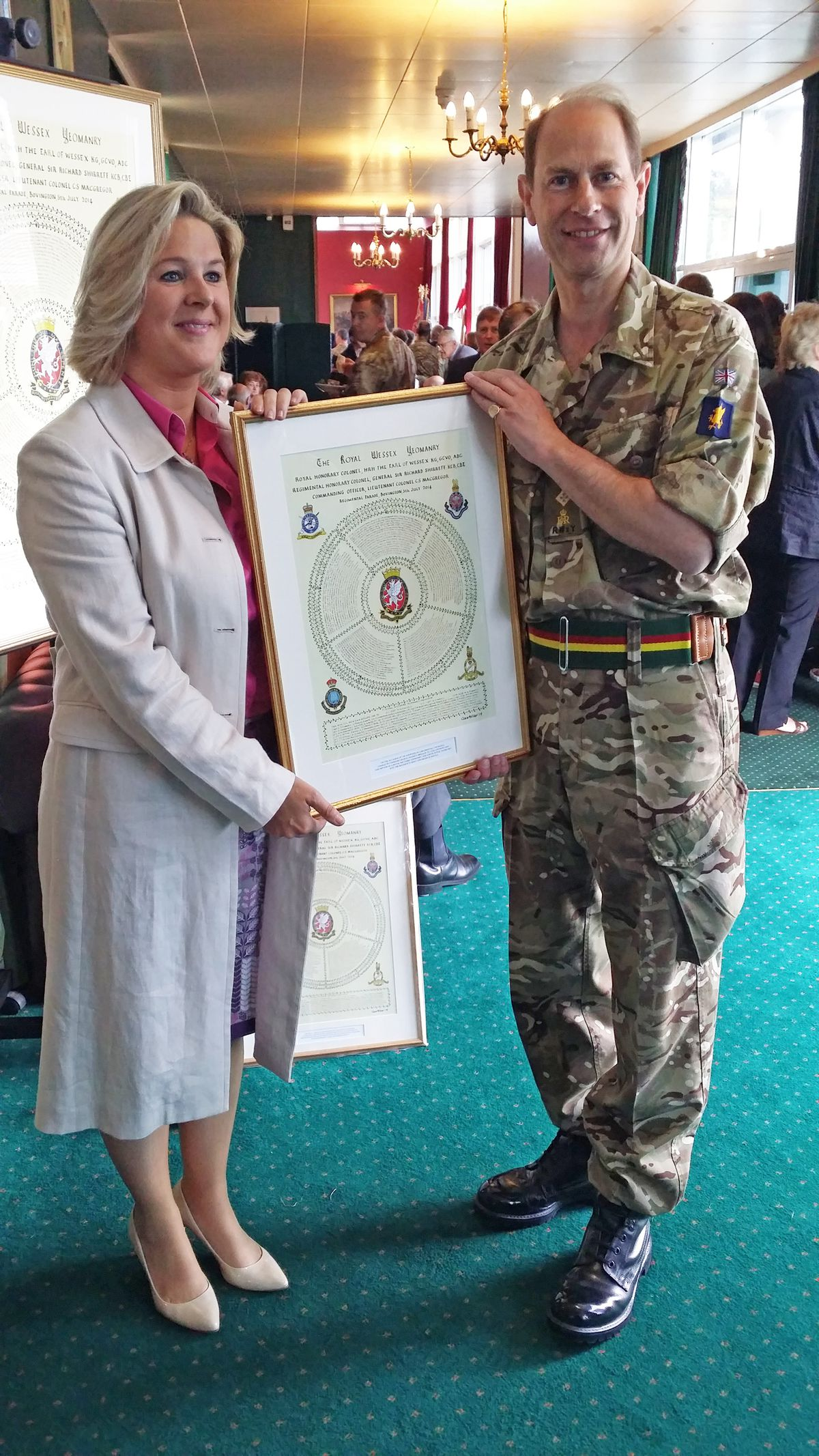 Clare Villar's presenting one of her works for the Royal Wessex Yeomanry to Earl of Wessex, Prince Edward in 2014.
