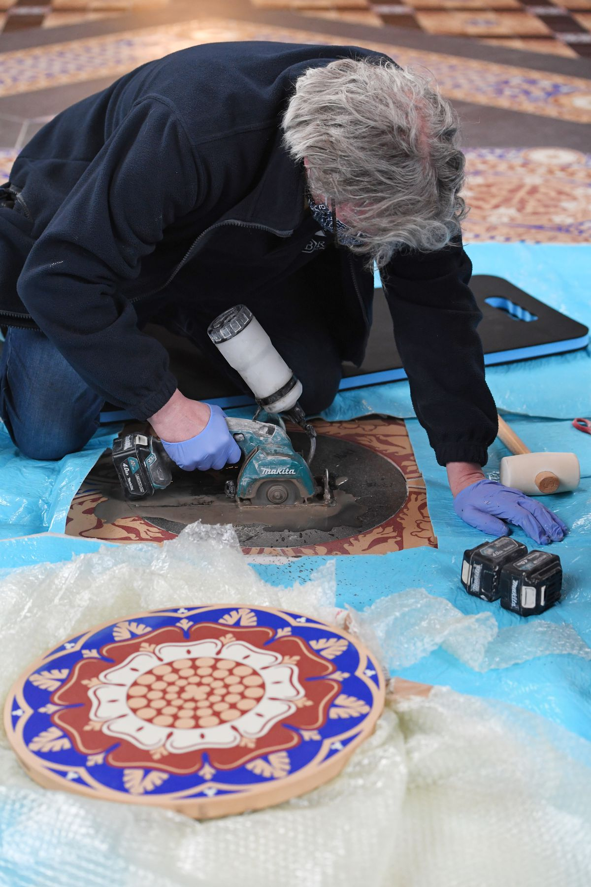 A worker preparing tiles. Pictures: Jessica Taylor