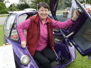 Rosemary Overton from Montford Bridge with her 1962 Heinkel Trojan at the annual classic car show at Holy Trinity Church, Meole Brace,