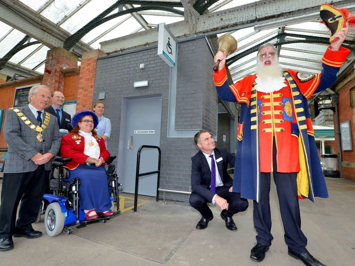 Town crier Martin Wood outside the new toilets at Shrewsbury Railway Station