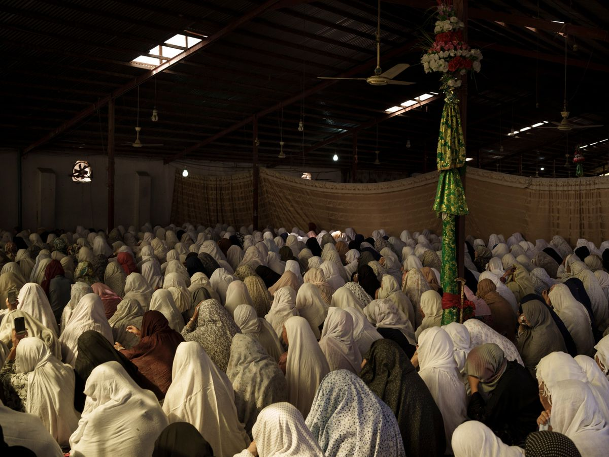 Afghan women pray in a mosque in Kabul