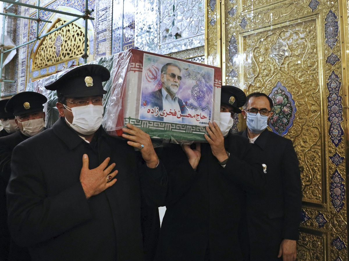 The coffin of Mohsen Fakhrizadeh is carried during a funeral ceremony in Mashhad, Iran
