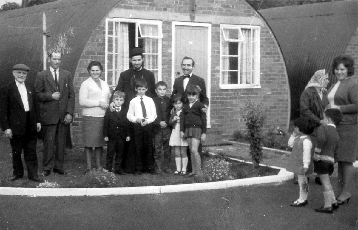 The beginnings of Telford's Yugoslav community. This is 'O' Camp, Donnington, which housed European Voluntary Workers, and was established in 1951. This undated picture shows a visit by a Serbian bishop. One of the little boys is Marko Jakovljevic. Marko's family are on the left, and the Ilic family are on the right. Picture: Phil Fairclough.