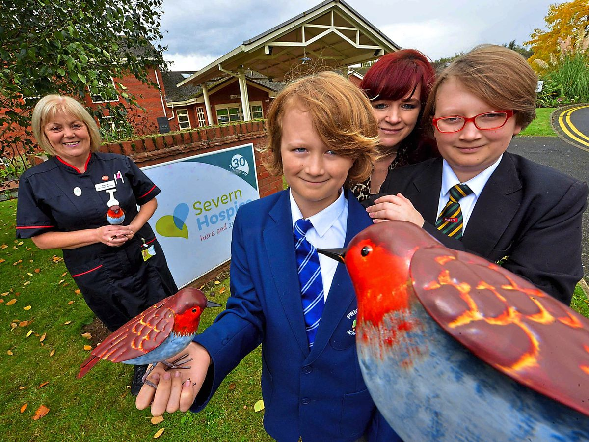 Pip Haywood and his mother Becki and brother Oskar with the new robins presented by Severn Hospice matron Helen Duce