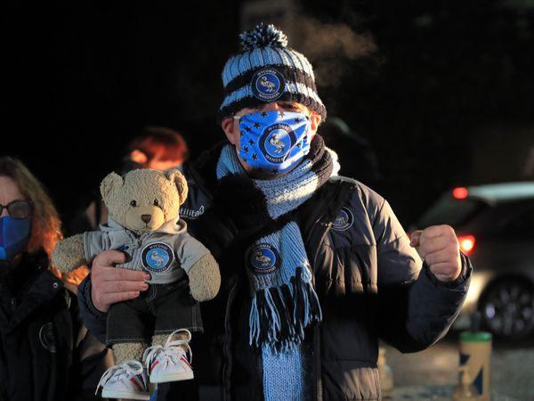 Wycombe fan Colin Pocock - and his teddy - attend the team's match against Stoke on December 2