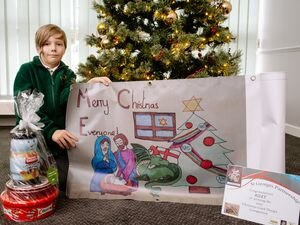 St Georges C of E Primary School pupil Riley Escott, aged nine, shows off her winning design