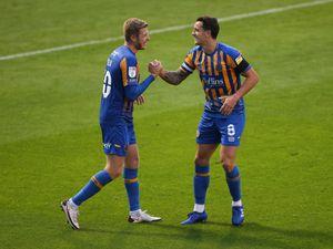 Josh Vela and Ollie Norburn of Shrewsbury Town celebrate after Jason Cummings scored a goal to make it 3-0. (AMA)