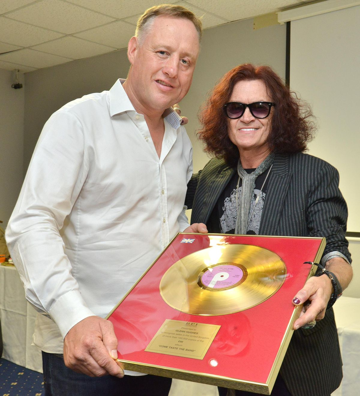 Rock Legend Glenn Hughes pictured with Bar Sport owner Scott Murray before his gig at the Premier Suite Lounge, Bar Sport, Cannock in 2017