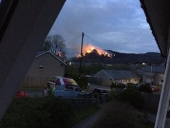 Homes evacuated amid large mountain blaze