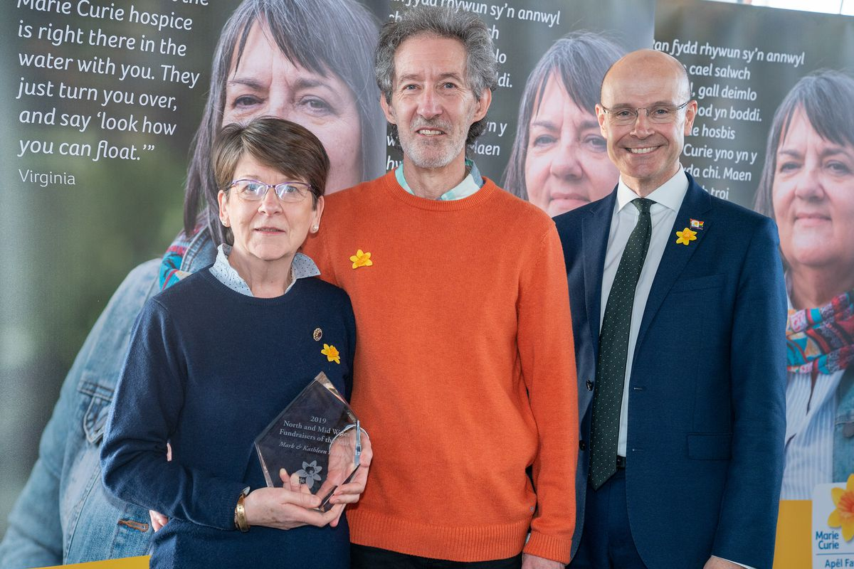 Mark and Kathleen Harvey with Marie Curie chief executive Matthew Reed